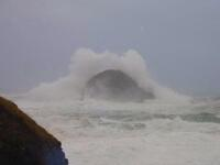 Wave breaking over Gull Rock at Trebarwith Strand