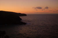 Sunset over Varley and Kellan heads from Port Isaac