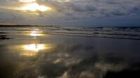 Sun reflecting on Tregardock Beach